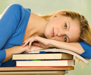 Magic Student Resting on Card College Books